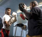 Anwar Jones, 15, learns how to box with member William Edney.